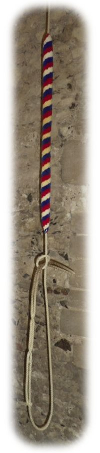A bell rope with its red, white and blue sally