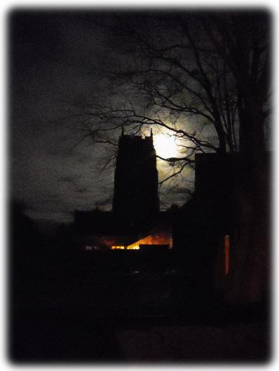 St. Mary's Tower,Holme-next-the-Sea. A moody view with the moon backlighting the tower - Photo © Tony Foster